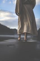 Jesus walking along a shore