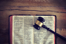 gavel on an open Bible