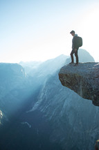 a man standing at the edge of a cliff