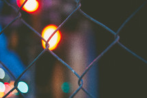 chain link fence and bokeh Christmas lights