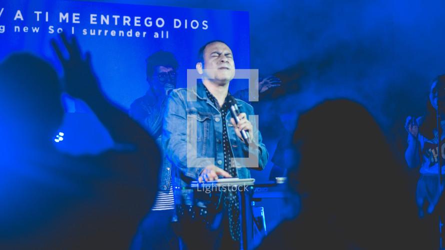 a man singing during a worship service