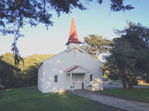 rural white church with steeple