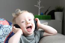 toddler boy listening to headphones
