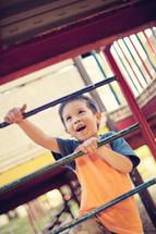 a boy child climbing on a playground
