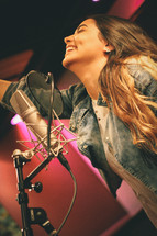 woman singing in a studio