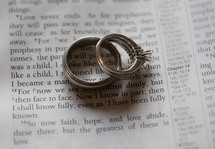 wedding ring and engagement ring on the pages of a Bible