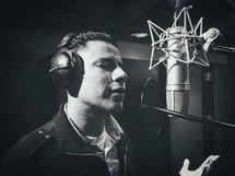 man singing in a studio