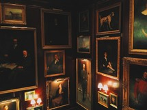 framed portraits hanging on a wall.
