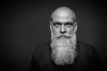 An image of a bearded bald man