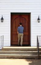 a young man entering a church
