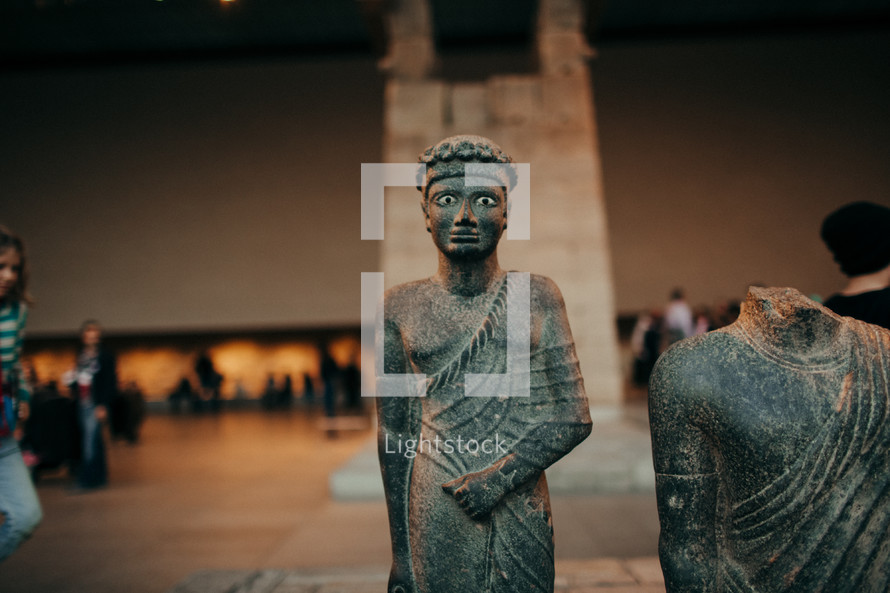 ancient sculpture in a museum
