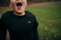 boy with an open mouth