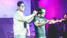 blindfolded on stage