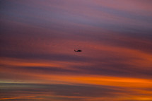helicopter in the sky at sunset