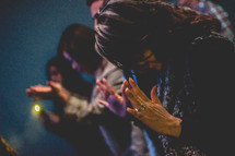 parishioners in prayer during a worship service