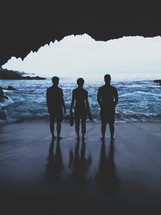 standing at the mouth of a sea cave