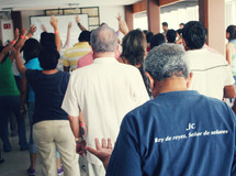hands raised in praise to God at a worship service