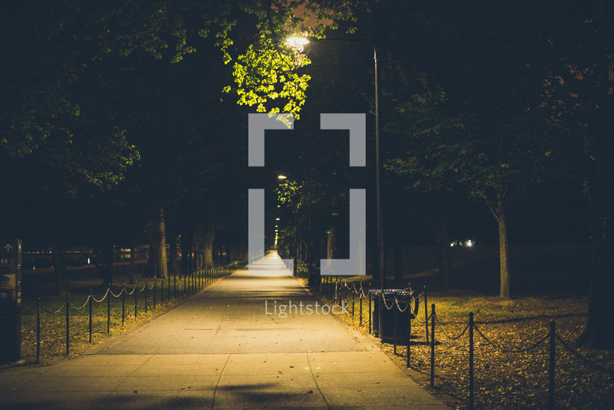 paved park walkway at night