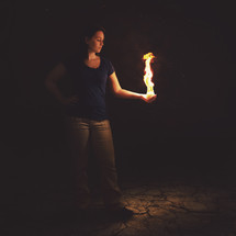 woman holding fire