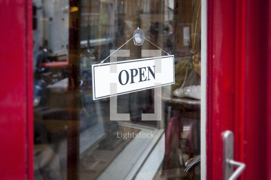 open sign on a store door