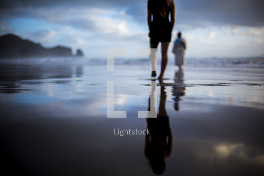 a man following Jesus on a beach