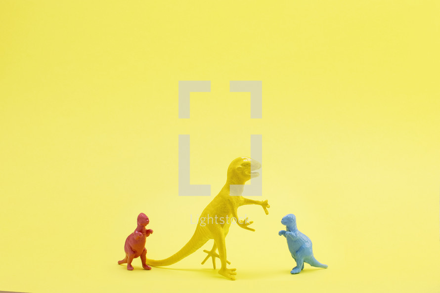 dinosaur figurine on yellow background
