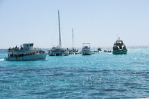 crowded boats on water