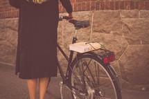 woman pushing a bicycle