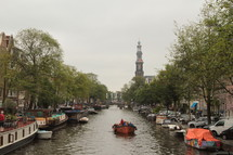 Boat glides along the canal in Amsterdam