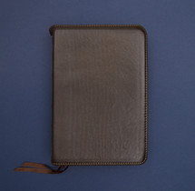 leather bound Bible on blue