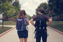 students with backpacks walking to class