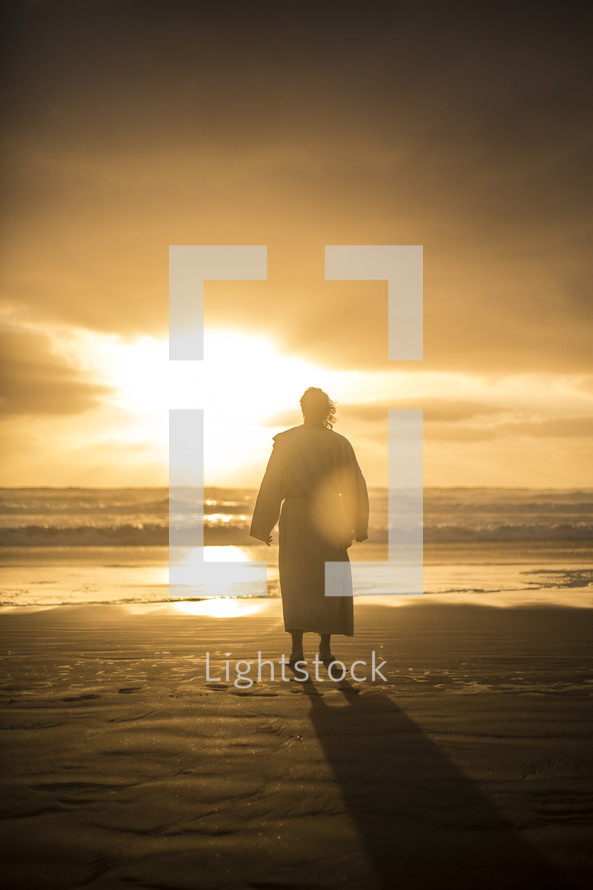 Jesus standing on a shore at sunrise