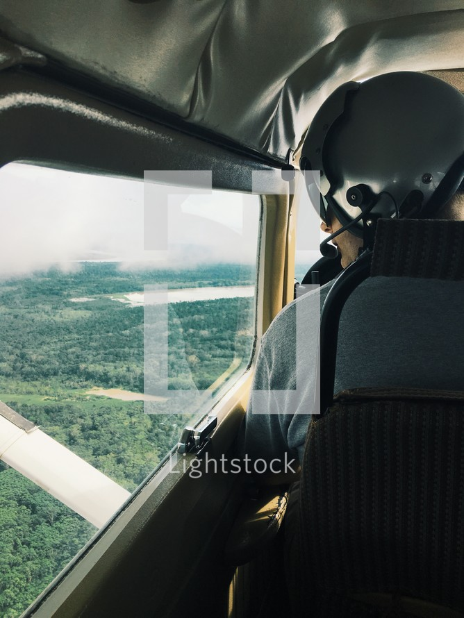 a pilot looking out a window