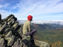 man looking out at mountains