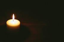 flame on a white candle