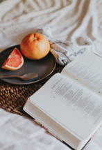 grapefruit and open Bible
