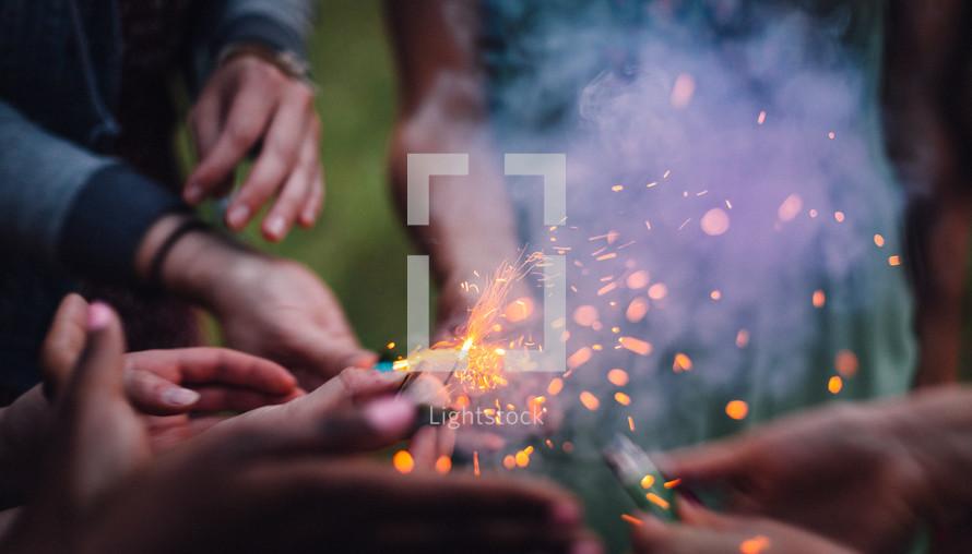 People lightning fireworks
