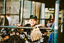 kids in a dugout at a baseball game