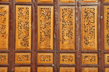 Chinese paneled door with ornate carved detail