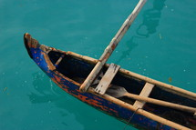 canoe on blue water