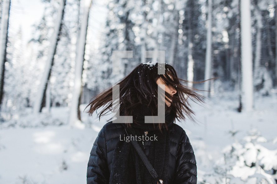 a woman standing in falling snow