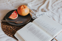 open Bible and grapefruit