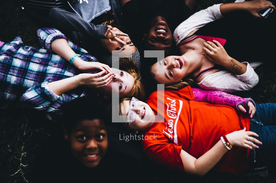 a group of kids lying on the ground