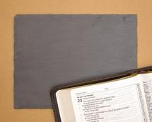blank slate and open Bible