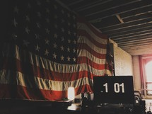 Large American flag and 1 01 sign