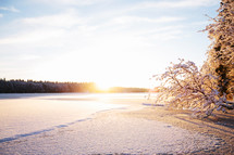 sunrise over a snow covered field