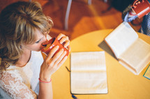woman reading a Bible at a Bible study