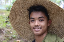 a young farmer man in a straw hat