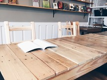 an open book on a table in a library