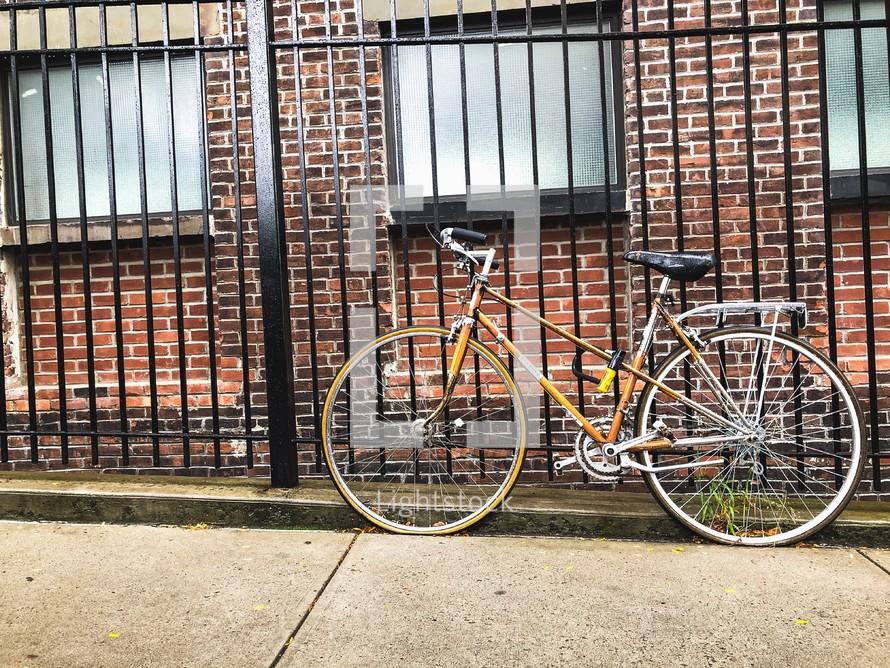 bike locked to a fence